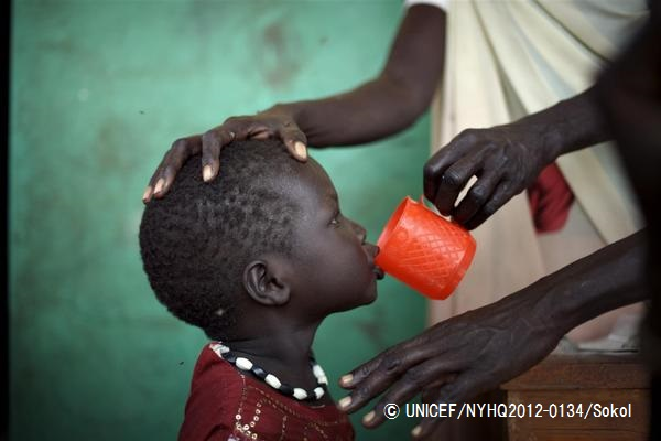 A woman of the Murle tribe gives deworming medication to her son, at Pibor Boys Primary School, in Pibor Town, Pibor County, Jonglei State. They were displaced by inter-ethnic violence. The school is serving as a centre for a UNICEF-assisted supplementary feeding programme, run by the Swiss NGO Medair, which is providing nutritional aid to 2,000 conflict-affected children.  In February 2012, South Sudan celebrated seven months of independence from Sudan – achieved on 9 July 2011. But scars left by a decades-long civil war are still evident: widespread chronic food insecurity; acute malnutrition, exceeding 20 per cent in certain areas; severely limited access to basic services, including health care, improved sources of drinking water and sanitation facilities; and high rates of under-five and maternal mortality. Inter-ethnic violence also remains endemic, particularly in the eastern Jonglei State. In one example in late December 2011, a longstanding rivalry between the Lou Nuer and Murle tribes again erupted. After raiding the Murle village of Likuangole in Pibor County, the Lou Nuers went on to attack the Murle village of Gumuruk, then Pibor Town, where many conflicted-affected people had sought refuge after the initial attacks. The strikes were intended to counter the August 2011 Murle attack, involving the abduction of Lou Nuer children and women, as well as cattle. By the end of January 2012, over 140,000 people throughout Jonglei State had been registered as needing aid due to inter-ethnic violence. UNICEF supports these relief efforts in the areas of water and sanitation, health, nutrition, education and child protection.
