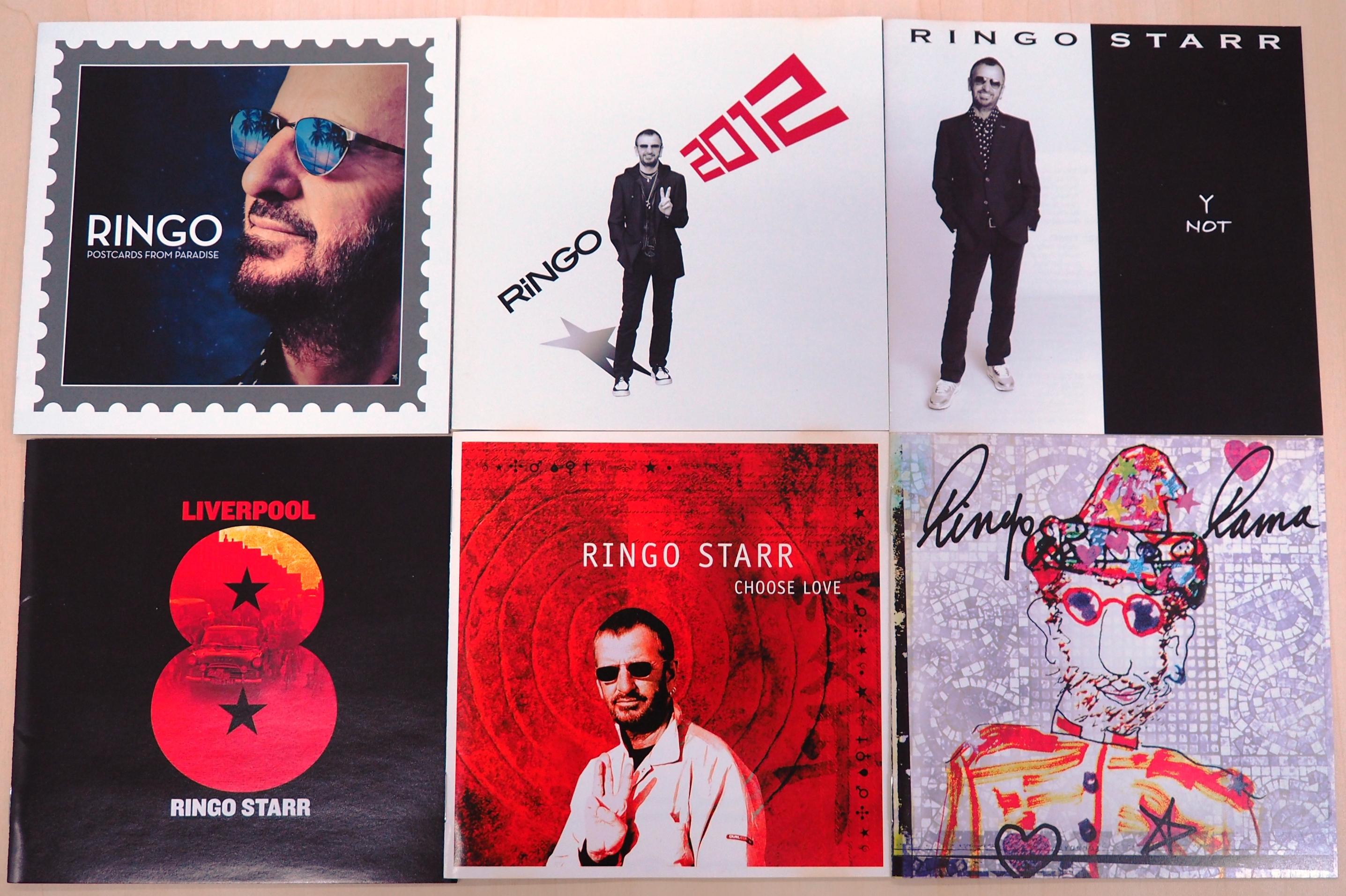 リンゴ・スターの今世紀発売された6枚のアルバム。上段左から右へ『ポストカーズ・フロム・パラダイス』、『リンゴ2012』、『ワイ・ノット』。下段左から右へ『想い出のリバプール』、『チューズ・ラヴ』、『リンゴ・ラマ』。