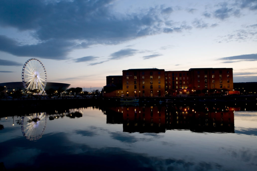 Sunset over waterfront towards Albert Dock, Liverpool, UK