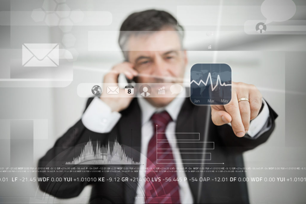 Businessman selecting stock application from touchscreen menu on grey background