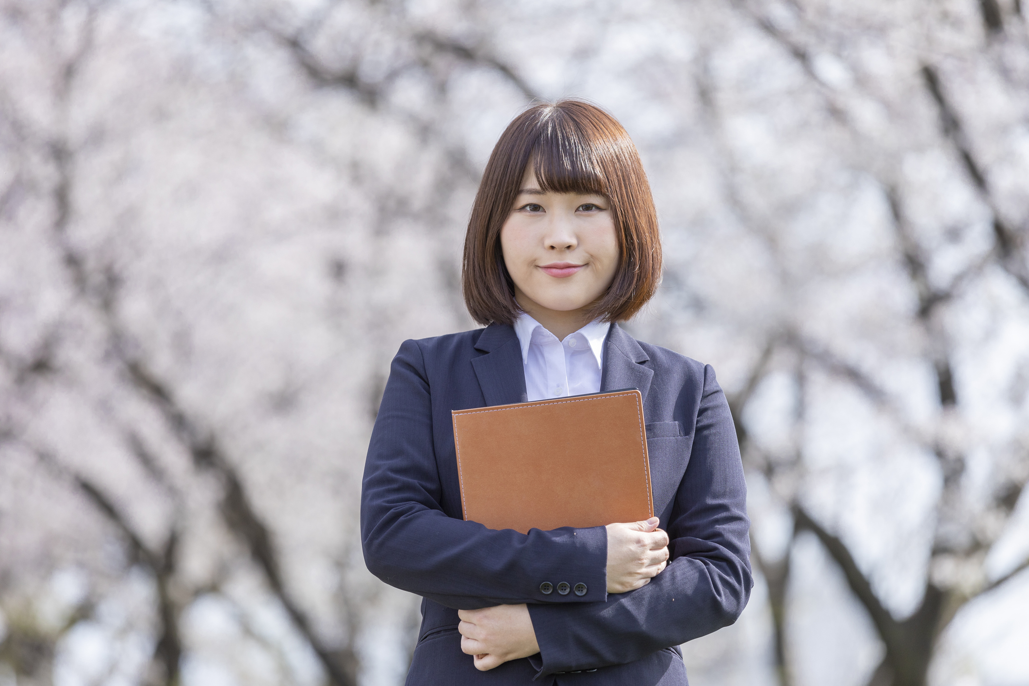 Woman in suit and cherry blossom