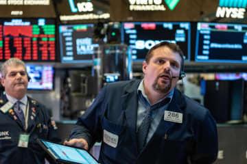 NY株、32年ぶり1割暴落 下げ幅最大、再び取引停止 画像1