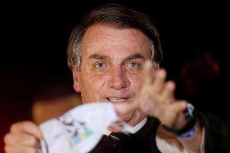 ブラジルのボルソナロ大統領=22日、首都ブラジリア(ロイター=共同)