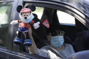 米で感染者が急増、営業再開阻む アップルやディズニー 画像1