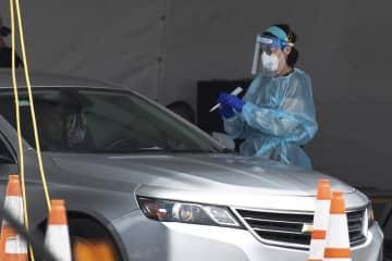 米死者、11月に24万人推計 南部州知事が初感染 画像1