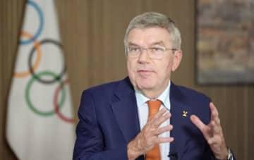 IOC会長「トンネルの先の光」 東京五輪の開幕まで1年 画像1