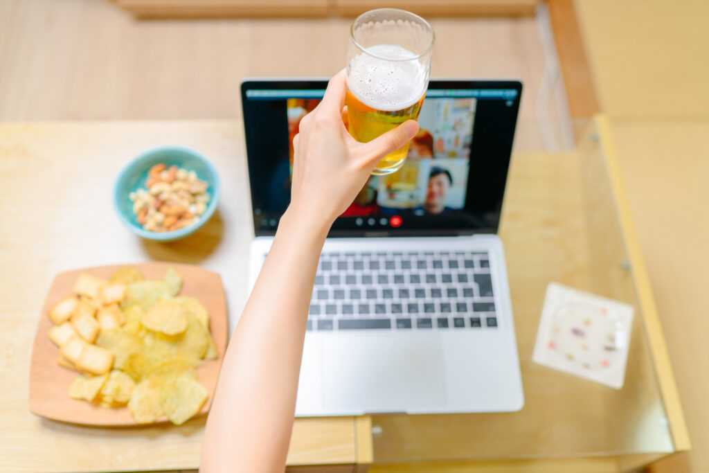 Close-up photo of human hand while having fun with loved ones via conference call on laptop at home