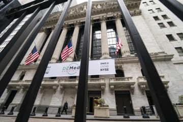 NY株5日続伸、92ドル高 経済対策に期待 画像1