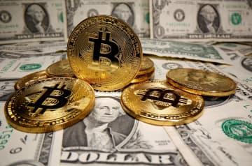 ビットコイン、初の5万ドル突破 仮想通貨、テスラ投資で上昇加速 画像1
