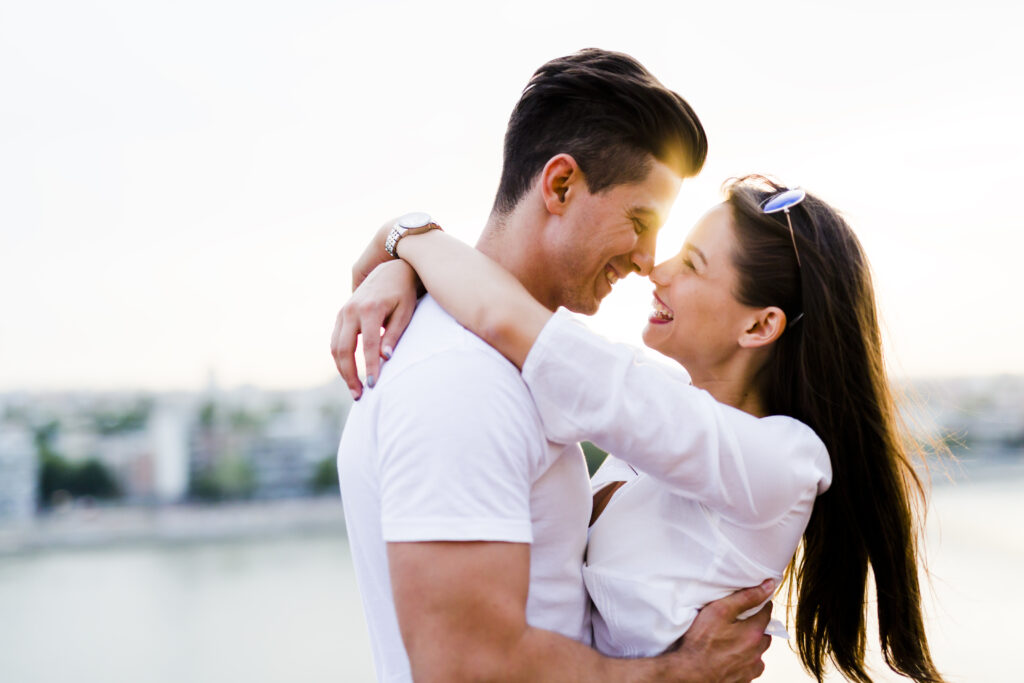 Young beautiful couple hugging and about to kiss