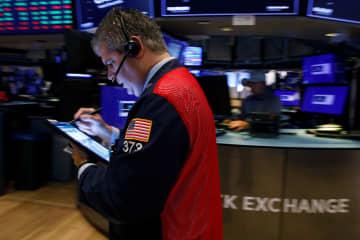 NY株反発、242ドル高 緩和縮小前倒し懸念後退 画像1
